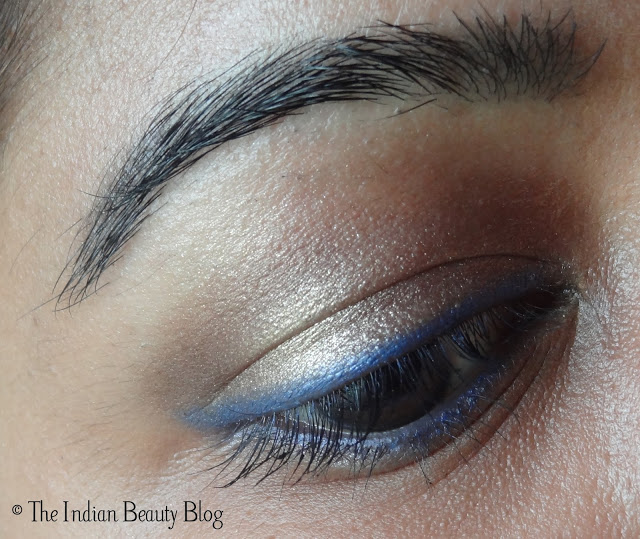 copper brown eye makeup with blue eyeliner