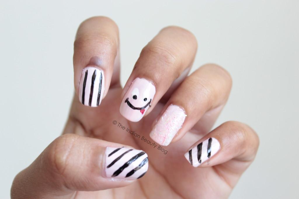 pastel pink smiley nail art
