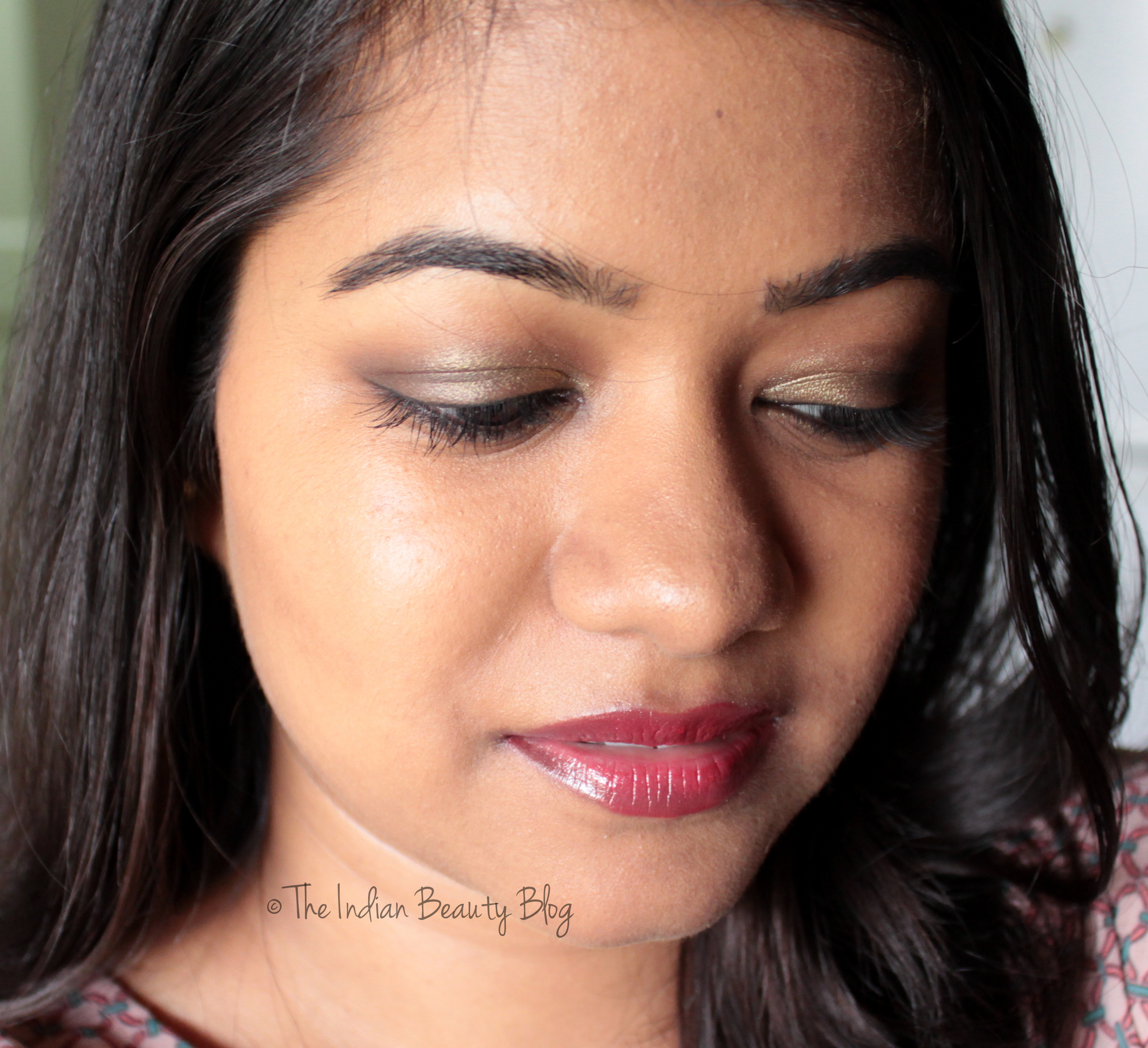 Current go-to party makeup look: Golden brown smokey eyes with red lips!